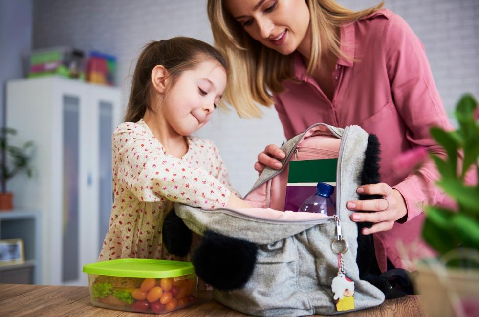 Mum packing daughter's school bag